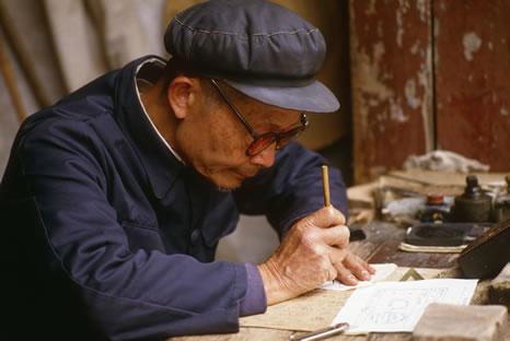 A scribe working in Yangshou, China