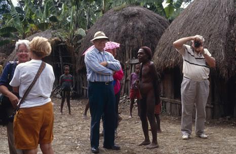 Tourists visiting  Dani Village, Irian Jaya, Indonsia
