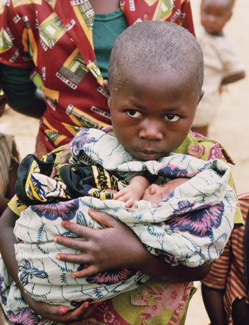Child holding young baby, Benin